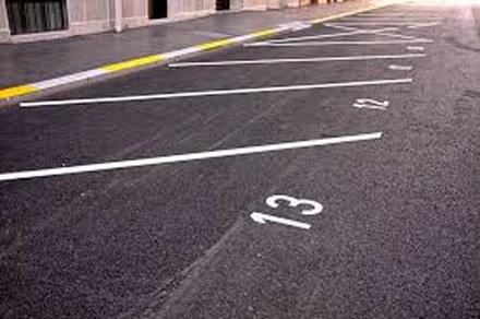Angled Parking with Numbers Marked on Newly Sealcoated Parking Lot