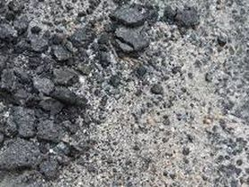 Old Crumbling Asphalt becoming Stone Chips and Sand